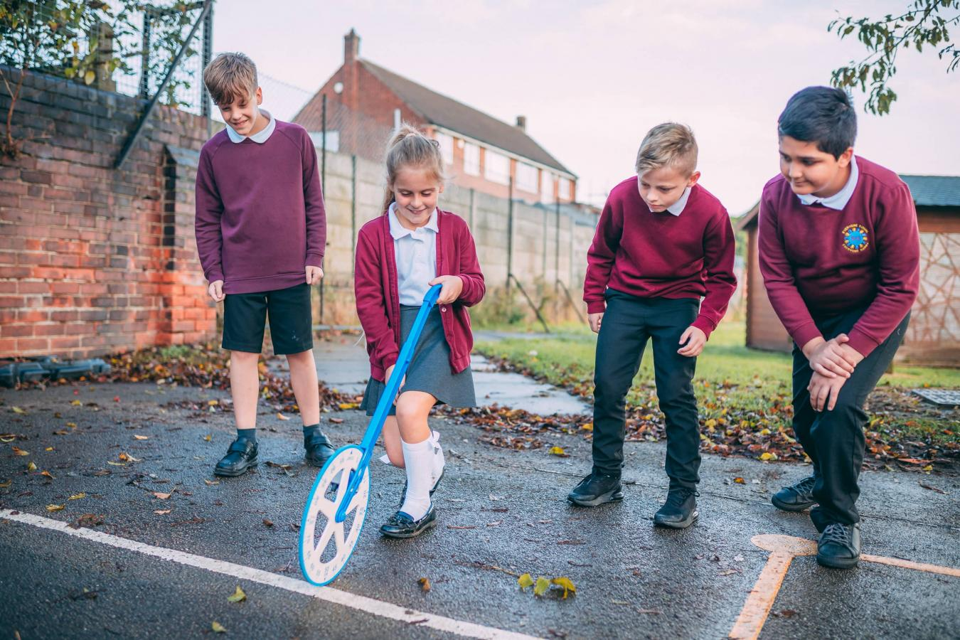 Pupils using a measuring wheel