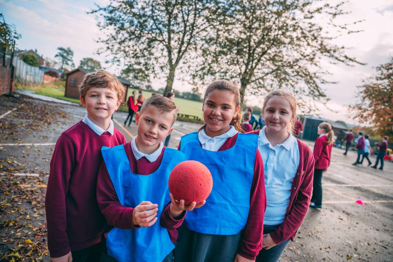 Pupils playing with a ball