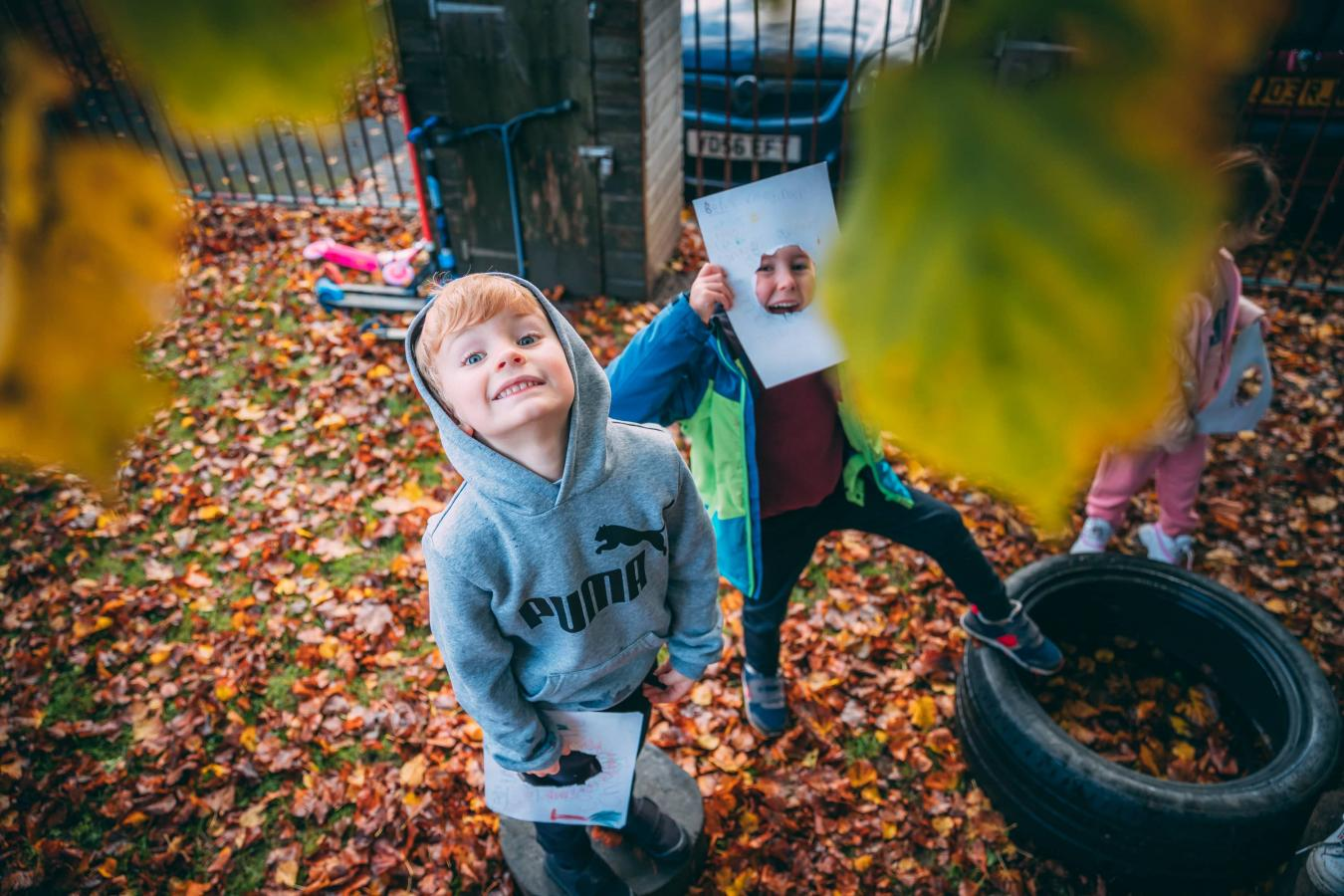 Pupils looking at leaves