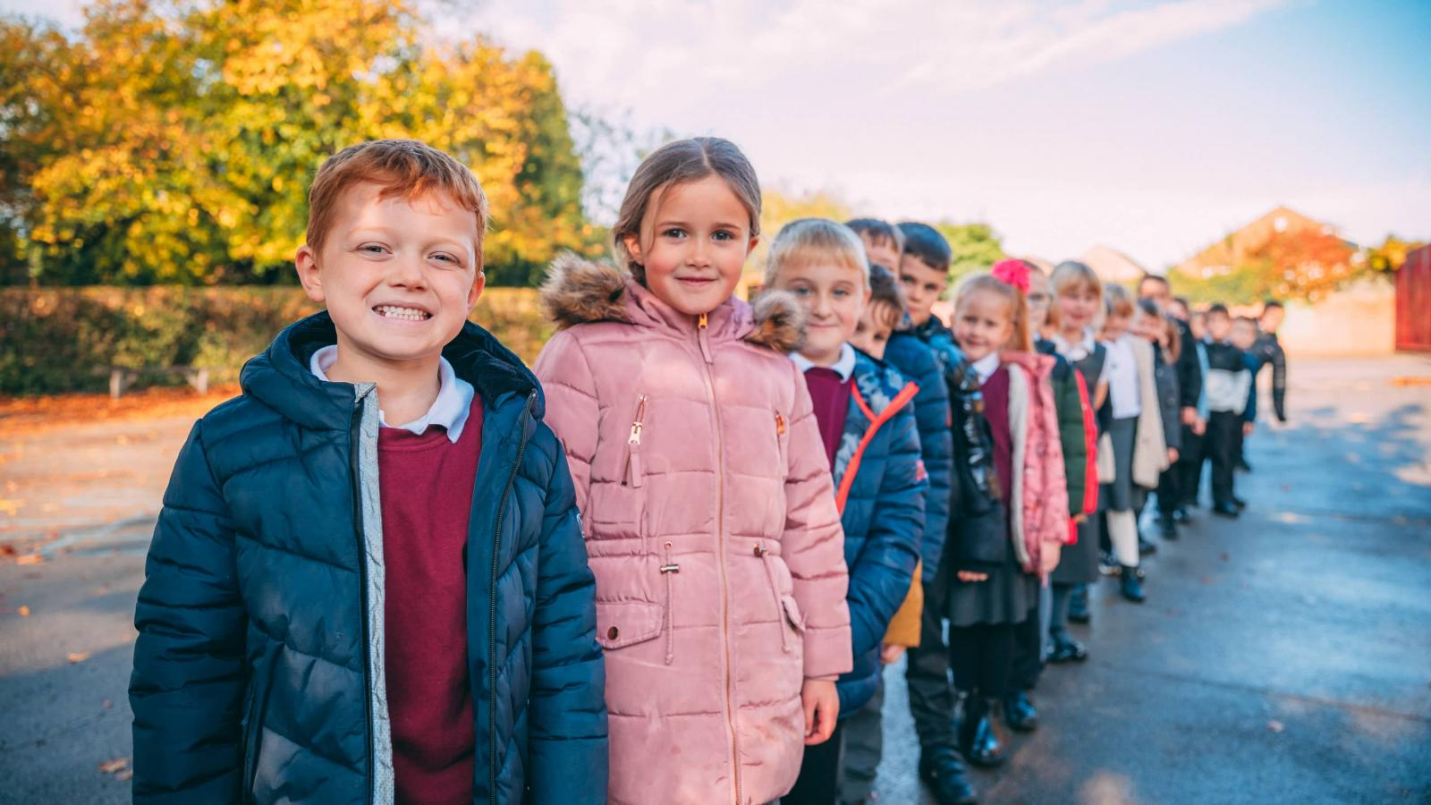 Pupils line up in the playground
